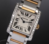 Cartier 'Tank Francaise'. Mid-size ladies watch, 18 kt. gold and steel with diamonds