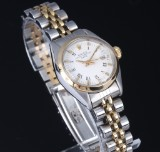 Rolex 'Date'. Ladies watch, 18 kt. gold and steel, white dial, c. 1979