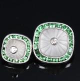 A pair of cufflinks, 18 kt. white gold with quartz and green garnet