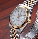 Rolex Datejust. Mid-size ladies watch, 18 kt. gold and steel with white dial, c. 1986