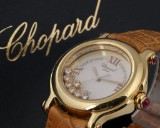 Chopard 'Happy Sport'. Ladies watch, 18 kt. gold with diamonds and rubies