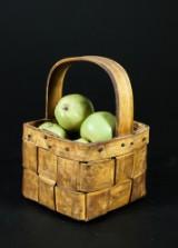 Ingrid Herrlin. Ceramic apples in a basket
