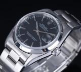 Rolex 'Datejust'. Midsize dameur i stål med sort skive, ca. 2000