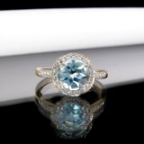 Rose gold ring with diamonds and blue topaz