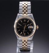 Rolex 'Datejust'. Vintage men's watch in 18k gold and steel with black dial, approx. 1970