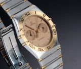 Omega 'Constellation Day-Date'. Men's watch, 18 kt. gold and steel, 1990s