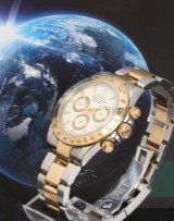Rolex Daytona. Men's watch, 18 kt. gold and steel with white dial, 2002