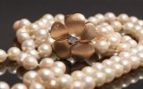 Ole Lynggaard, large flower clasp with diamonds and two Akoya saltwater cultured pearls