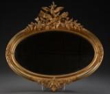 Ovalt spejl i ramme af forgyldt træ