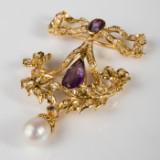 A brooch, 750 gold, with amethyst, natural pearl and 59 diamonds