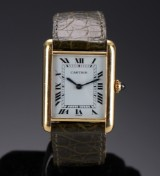 Cartier 'Tank'. Vintage ladies watch, 18 kt. gold with white dial, c. 1970-80s
