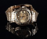 Tag Heuer. Men's watch, 'Series 6000', solid 18 kt gold
