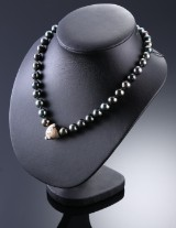 Per Borup.  Diamond clasp and necklace with Tahitian pearls