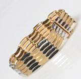 Armlænke udført i 18 kt. guld og hvidguld