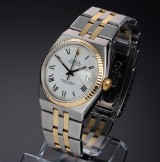 Rolex 'Oysterquartz Datejust'. Men's watch, 18 kt. gold and steel with date, c. 1980