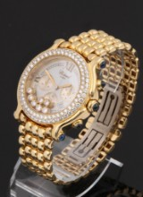 Chopard 'Happy Sport'. A large ladies watch, 18 kt. gold, with diamonds and sapphires