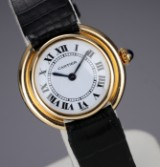 Cartier. 'Vendome' ladies watch in 18 kt. gold with original strap and clasp, c. 1980s