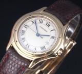 Cartier 'Cougar' unisex watch, 18 kt. gold, original strap and clasp, c. 1990's