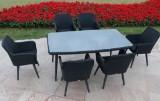 Havemøbelsæt. Seks polyrattan stole samt bord med glasplade. (7)