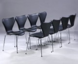 Arne Jacobsen. A set of eight chairs, 'Series 7', Model 3107, black leather, new seat height 46.5 cm. (8)