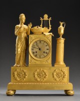 French empire mantle clock in gilt bronze