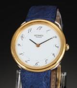 Hermès. Ladies watch, model Arceau, gold and steel
