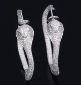 Elise Dray. A pair of large round Copra diamond earrings, total approx. 4.00 ct. (2)