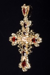 Large crucifix pendant of 585 gold with garnets and diamond