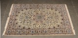 A hand-knotted Persian rug, Nain. 205 x 126 cm
