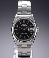 Rolex 'Date'. Vintage herreur i stål med sort skive, ca. 1962