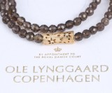 Ole Lynggaard. 'Blonde' clasp, 18 kt. gold with smoky quartz bead necklace (2)