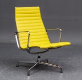Charles & Ray Eames. Aluminium Lounge Chair, model EA-115, yellow leather