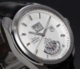 Tag Heuer 'Grand Carrera GMT'. Herreur i stål med lys skive, 2000'erne