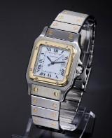 Cartier 'Santos'. Men's watch in 18 kt. gold and steel with date, 1990s