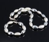 Moderne smykkesæt af delvis satineret sterlingsølv