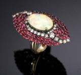 Large navette-shaped cocktail ring in 18 kt. gold and black rhodium-plated white gold with opal