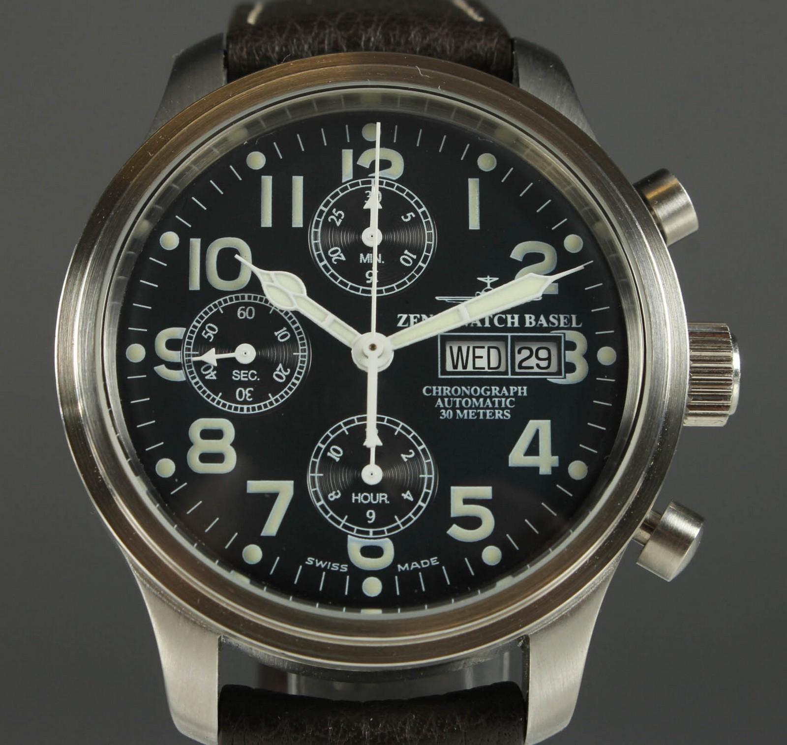 Zeno Watch Basel. Herre Chronograph Automatic - Zeno Watch Basel Chronograph Automatic. Model Ref. 9557. Urkasse af mat- poleret stål. Sort urskive med arabertal, Time.- minut samt seperat sekuntvisere, dag- og datogengivelse. chronograph/stopur-funktion. Valjoux automatisk værk cal. 7750,...