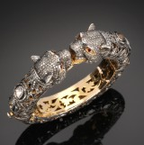 Oriental panther bangle, gold and silver, total approx. 12.00 ct