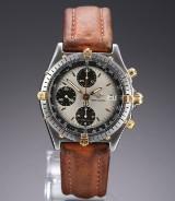 Breitling 'Chronomat'. Herreur i 18 kt. guld og stål med sølvgrå skive, 1990'erne