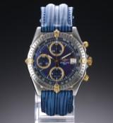 Breitling 'Chronomat'. Herreur i 18 kt. guld og stål med blåviolet skive, 1990'erne