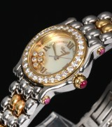 Chopard 'Happy Sport'. Ladies watch in 18 kt. gold and steel with diamonds and rubies