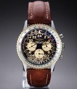 Breitling 'Navitimer Cosmonaut'. Herreur i guld og stål med mørk skive, ca. 1990'erne