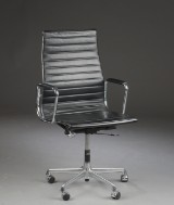 Charles Eames. Office chair, model EA 119. Black leather