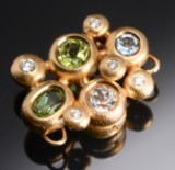 Ole Lynggaard. 'Bubble' clasp, with gemstones and diamonds