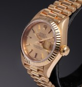 Rolex Datejust. Ladies watch, 18 kt. gold with champagne-coloured dial