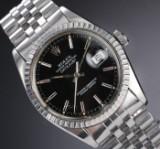 Rolex 'Datejust'. Herreur i stål med sort skive med dato, ca. 1981