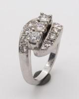 A Povl Klarlund brilliant cut diamond ring, 585 white gold, with 11 brilliant cut diamonds, ring size 52.5