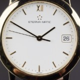 Eterna-Matic 'Reveil'. Men's watch, 18 kt. gold, with white dial,  2000s