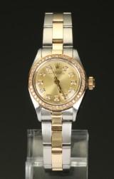 Rolex Oyster Perpetual 18kt guld/stål dameur med diamanter