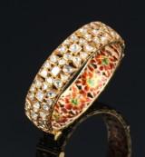 Oval oriental diamond and enamel bracelet in gilt silver